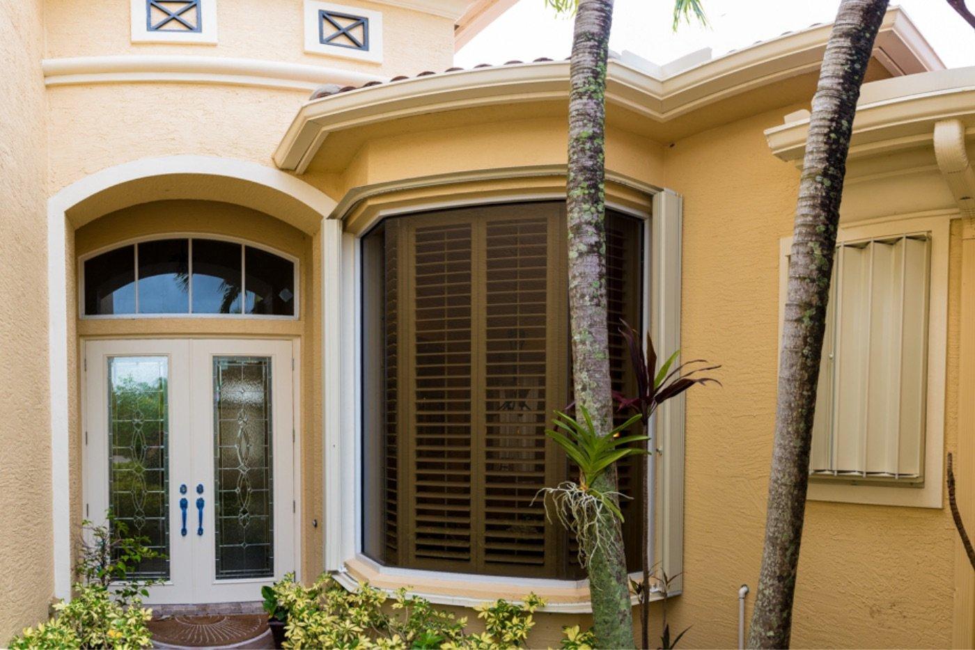 Accordion shutters on a palm beach home