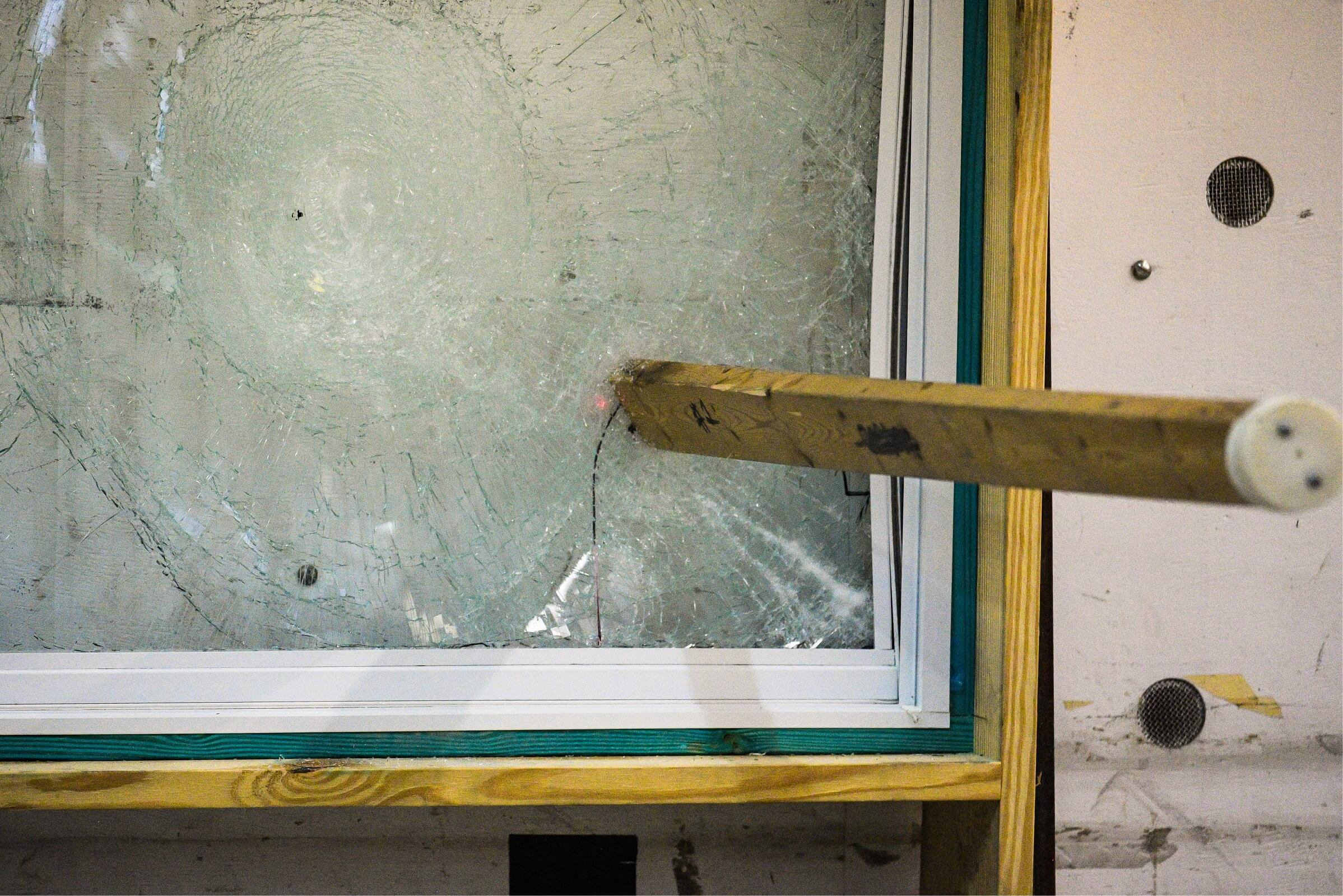 A hurricane impact window being tested for strength