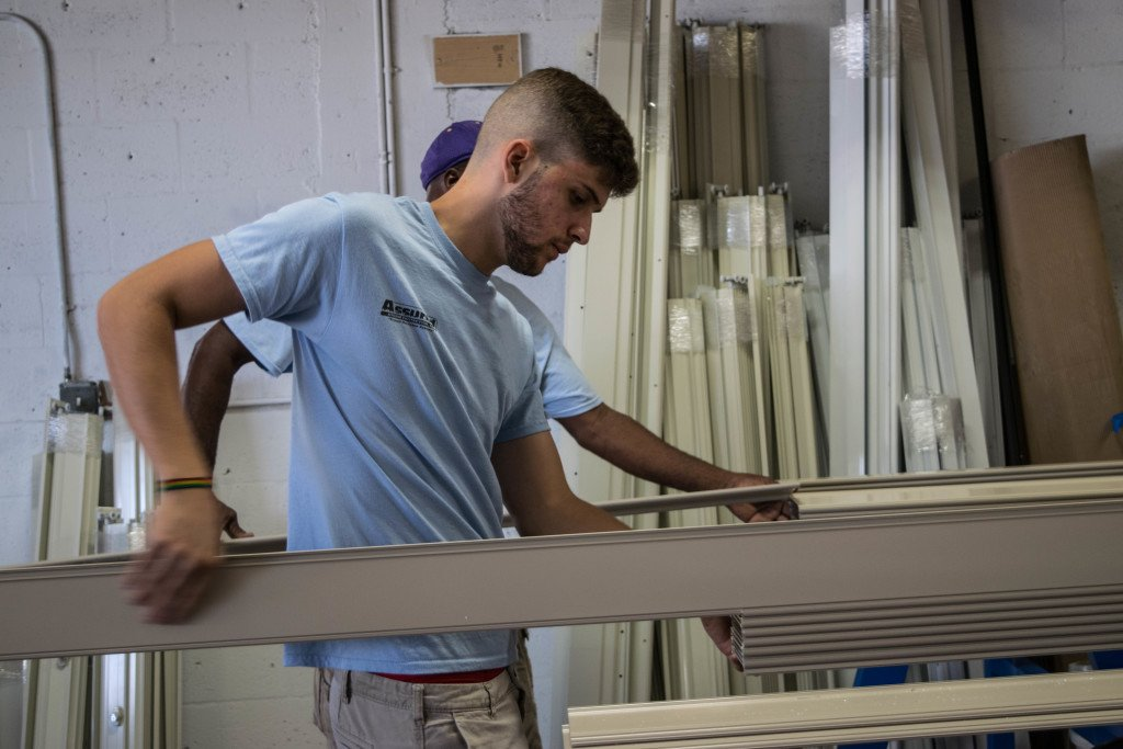One of our workers manufacturing hurricane shutters.