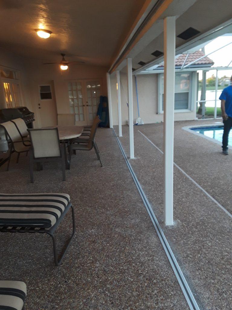 A recess-track Accordion Shutter Patio Enclosure installation